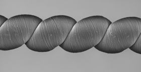 Coiled carbon nanotube yarns, created at the University of Texas at Dallas and imaged here with a scanning electron microscope, generate electrical energy when stretched or twisted. Image: University of Texas at Dallas.