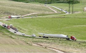 Transporting large wind turbine blades by road is expensive. The costs involved can amount to 3-5% of the total installed cost of each turbine.