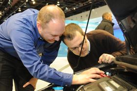 Automotive engineers pore over new vehicles on display at the North American International Auto Show in Detroit. In the engine compartment, metals are being replaced by new composite materials that can take the heat.