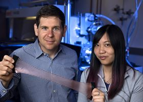 Alon Gorodetsky (left), UCI associate professor of chemical & biomolecular engineering, and Erica Leung (right), a UCI graduate student, show off the new composite material that can trap or release heat as desired. Photo: Steve Zylius/UCI.