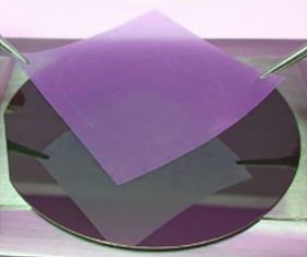 This is a photo of a wafer-sized, two-dimensional sheet of hexagonal boron nitride, which can be removed from a copper substrate and used as a dielectric in two-dimensional electronics. Photo: TSMC/Rice University.