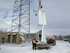 The rotary section of a WindStrip wind turbine is loaded on a truck for shipment to a communication tower site in southern Minnesota. The turbine is part of a joint project with the Minnesota Department of Transportation and will provide part of the primary and also back-up power for the towers operation.