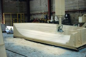 Engineered putty applied over the foam is machined to finish the direct-to-mould hull mould at Mollicam.