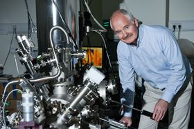 John Boland pictured with a scanning tunneling microscope. Photo: AMBER, Trinity College Dublin.