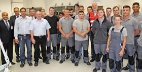 Garrelt Duin with apprentices and the GKN Management team at the GKN Sinter Metals plant.