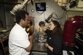 Lead author Zulipiya Shadike (right) with lead beamline scientist and co-author Sanjit Ghose (left) at NSLS-II's XPD beamline. Photo: Brookhaven National Laboratory.