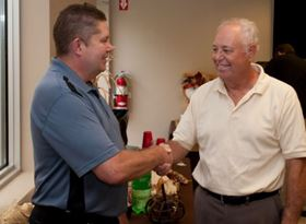 Bill Rosenberg, Sr. (right), founder of Columbia Chemical, congratulates Rick Holland at Rick's recent retirement party.