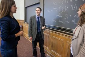 From left: Shiva Safaei, David Mazziotti and LeeAnn Sager discuss their finding that a dual state of matter with both fermion and exciton condensates could exist. Photo: University of Chicago.