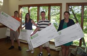 CCAI scholarship recipients receive their checks.
