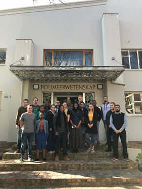 Group photo taken July 2018 in front of the Polymer Science building at Stellenbosch University.