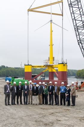 Project supporters and members of the DeepCwind Consortium stand with the VolturnUS 1.8 turbine, which features a composite tower.