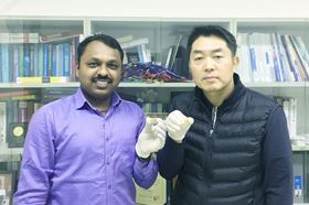 Dr Sawanta S. Mali (left) and Professor Chang Kook Hong (right) showing the perovskite solar cell devices fabricated at the Polymer Energy Materials Laboratory, Chonnam National University, South Korea, which approaches 20% efficiency. (Photo credit: Seong Il Oh.)