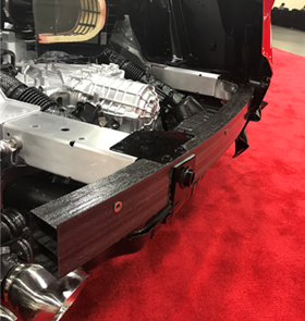 Scott Bader's Crestapol resins have produced a carbon fiber component that helps to protect the rear and expanded boot of the Corvette.
