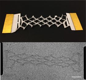 A stretched graphene kirigami spring (bottom) and a paper model (top). The traditional paper art of kirigami translates down to the microscale, providing a simple but powerful technique for building moving parts from graphene. Scale bar is 10 um. Credit: McEuen Group, Cornell University.