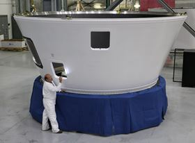 An Orbital ATK employee inspects an Atlas V boat tail, the 500th large composite rocket structure produced at the company's Iuka, Mississippi, facility for United Launch Alliance launch vehicles. (Photo: Business Wire)