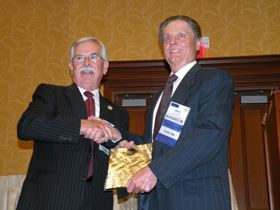 Jerry Wahlin (right), AAA Plating & Inspection, Inc., accepts the Silvio Taormina Award, one of NASF's highest honors.