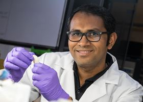 Rice University research scientist Muhammad Rahman holds a flexible dielectric made of a polymer nanofiber layer and boron nitride. Photo: Jeff Fitlow/Rice University.