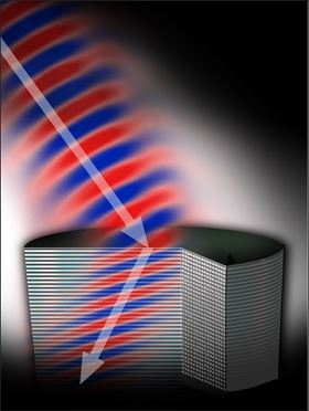 The shape and positioning of the rods in this metamaterial cause light – the arrow – to bend at a negative angle, a process called negative refraction. Better understanding of this dynamic will speed the development of new metamaterials such as perfect lenses and invisibility cloaks, says Michigan Tech's Elena Semouchkina. Image: Navid Ganji, Michigan Tech.