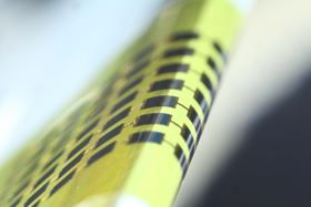 The new ultra-thin solar cells are flexible enough to bend around small objects, such as the 1mm-thick edge of a glass slide, as shown in this photo. Photo: Juho Kim, et al/APL.