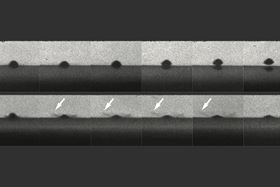 The top row of photos shows a particle that melts the surface on impact and bounces away without sticking. The bottom row shows a similar particle that does not melt and does stick to the surface. Arrows show impact sprays that look like liquid, but are actually solid particles. Image courtesy of the researchers.