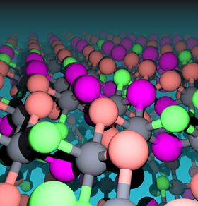 This image shows the atomic landscape of chromium halides. The magnetic chromium atoms appear as gray spheres and the non-magnetic ligand atoms as green (chlorine), orange (bromine) and magenta (iodine) spheres. Image: Fazel Tafti.