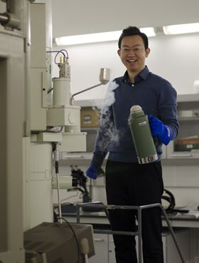 PhD student An Bao using one of the TEMs in the Materials Science and Metallurgy Department's electron microscopy facility.