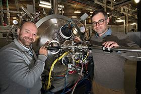 Brookhaven Lab physicists Claudio Mazzoli (left) and Mark Dean (right) at the Coherent Soft X-ray Scattering (CSX) beamline at the National Synchrotron Light Source II. Mazzoli, Dean and their colleagues were able to use this beamline to image some magnetic domains in an iron-based 'antiferromagnetic' material. Photo: Brookhaven National Laboratory.
