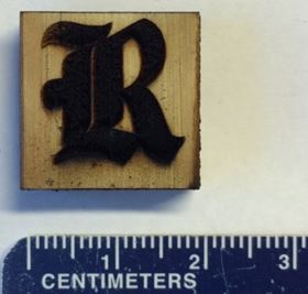 This Rice University athletics logo is made of laser-induced graphene on a block of pine. Image: Tour Group/Rice University.