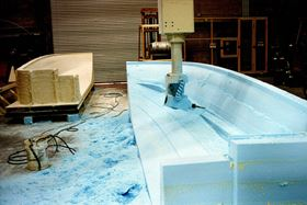 Foam is machined using a 5-axis CNC router for a direct-to-mould boat hull project at Mollicam.