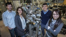 The Berkeley Lab research team  (left to right) Chris Jozwiak, Alessandra Lanzara, Kenneth Gotlieb and Chiu-Yun Lin  standing next to the SARPES detector. Photo: Peter DaSilva/Berkeley Lab.