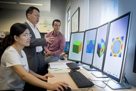 Doctoral student Bo Peng (left), associate professor Wenbin Yu (center) and doctoral student Ernesto Camarena (right) conduct research on SwiftComp. Image: Purdue Research Foundation.