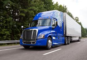 Daimler Trucks North America's blue cabin Cascadia truck on the road.
