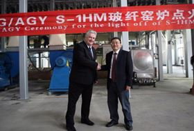 Mr. Drew Walker, President and CEO of AGY (left) shakes hands with Mr. Zhiyao Tang, Chairman and President of CTG/Taishan Fiberglass (right) confirming the launch of S-1 HM™ glass fibre production.