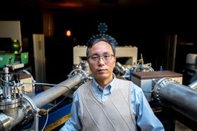 Jiming Bao, associate professor of electrical and computer engineering at the University of Houston, led an international group of researchers investigating how a two-dimensional perovskite composed of cesium, lead and bromine was able to emit a strong green light. Photo: University of Houston.