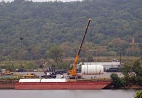 The tanks were loaded on a barge for transport on the Ohio and Mississippi Rivers to the Gulf of Mexico.