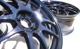 "Prismatic Powders expands its You Tube Video Gallery of coating color options. Pictured is ""Ink Black"" on an automotive wheel application."