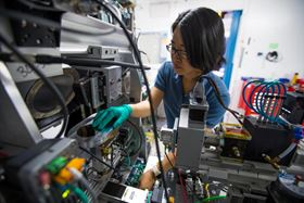 This photo shows Fang Ren, who developed algorithms to analyze data on the fly while a postdoctoral scholar at SLAC, at a Stanford Synchrotron Radiation Lightsource beamline. Photo: Dawn Harmer/SLAC National Accelerator Laboratory.