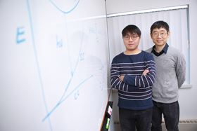 Xiaoming Wang (left) and Yanfa Yan (right) from The University of Toledo are part of an international team that has discovered a single material that produces white light. Photo: Dan Miller, The University of Toledo.