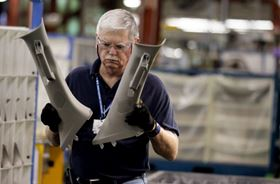 General Motors employee Ray Smith works on sub-assembly of A-pillars for the Chevrolet Traverse at the GM Spring Hill plant in Tennessee.