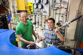ORNL's Andrew Christianson (left) and Stuart Calder (right) conducted neutron diffraction studies at the lab's High Flux Isotope Reactor to clearly define the magnetic order of an osmium-based material. Photo: ORNL/Genevieve Martin.