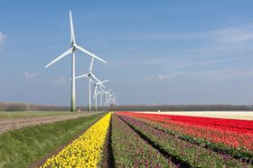 The increasing size of wind turbines poses a big challenge to design lightweight blades that meet performance requirements in terms of stiffness and fatigue. (Picture used under license from Shutterstock.com © T.W. van Urk.)