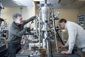 Dr Gavin Bell and Dr Yorck Ramachers working on the solar power device in the laboratory