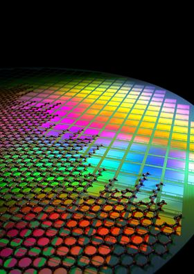 Artistic impression of graphene-quantum dot photodetectors integrated with CMOS read-out circuitry. Each square represents one image sensor (with >100,000 photosensors), and the total area represents the Si-CMOS wafer on which large-volume processing is performed.