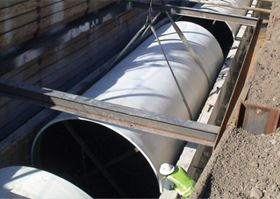 Denver sewer pipe installed in bottom portion of concrete culvert.