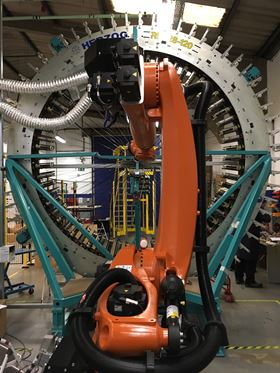 The multi-axis Kuka robot system has a reach of over 3 m.