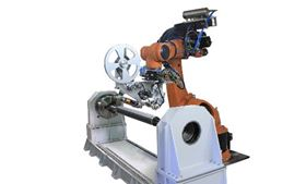 The AFP/ATL Robot Machine allows for fast transition from automated placement of fibers to automated laying of tape and vice versa, by changing the head.