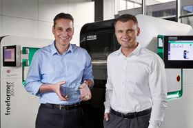 Lukas Pawelczyk, head of Freeformer sales (right), and Martin Neff, head of plastic freeforming. (Photo courtesy Arburg.)