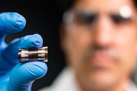 Rice University engineer Rafael Verduzco holds a flexible solar cell developed by his lab. Photo: Jeff Fitlow/Rice University.