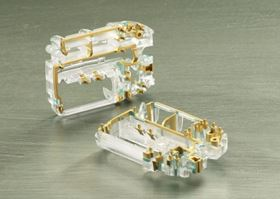 A double-shot molded MID chassis with gold plated circuits for a disposable insulin pump.