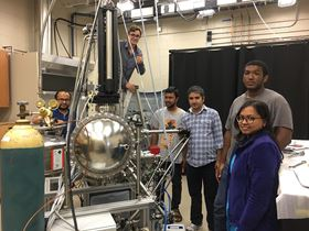 Madhab Neupane and his research team with their in-house ARPES system. From left to right: Gyanendra Dhakal, Klauss Dimitri, Md Mofazzel Hosen, Madhab Neupane, Christopher Sims and Firoza Kabir. Photo: University of Central Florida.